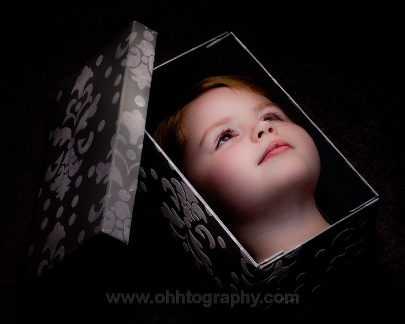 Kid in a box. - Randomness.