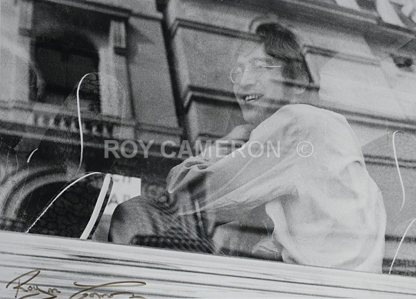 John Lennon on bus - Rare Beatles pics.