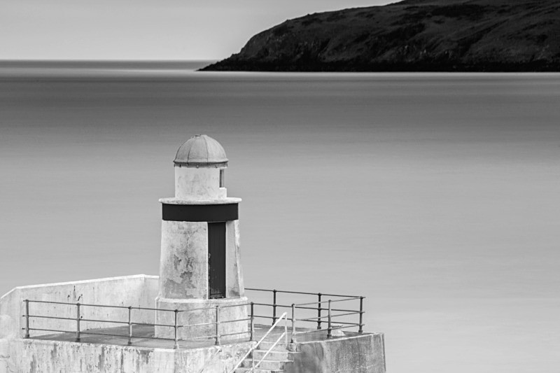 Laxey Harbour Light - Man in Mono