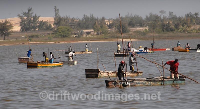 Senegal Lac Rose salt production boats on lake - Salt Production in Senegal