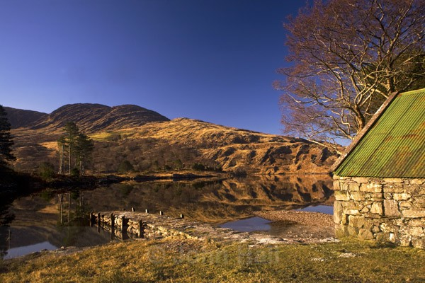 reflections and boathouse, gleninchaquin, ireland.