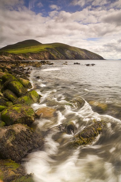 A Wave Breaks On The Shore At Minard, Co. Kerry, Ireland.
