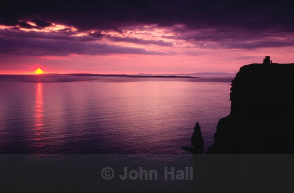 sunset at cliffs of moher, co. clare, ireland.