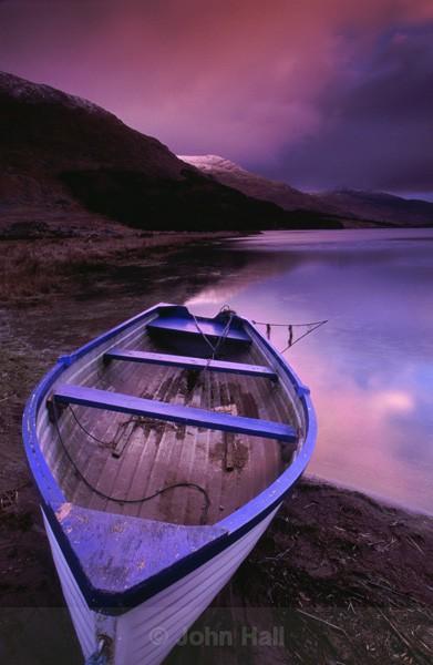 boat on lake at sunrise,black valley,co. kerry,ireland.