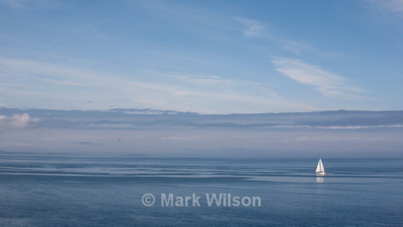 yacht and the isle of coll from dun ara - Land and seascapes