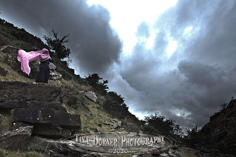 Storm clouds anf figure with pink veil. by Tina Dorner Photography, Forest of Dean and Wye Valley, Gloucestershire