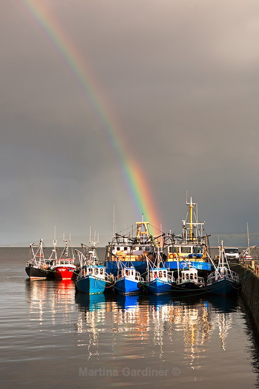 Rainbow over  Boats at Carrickarory Pier - Ireland by Day