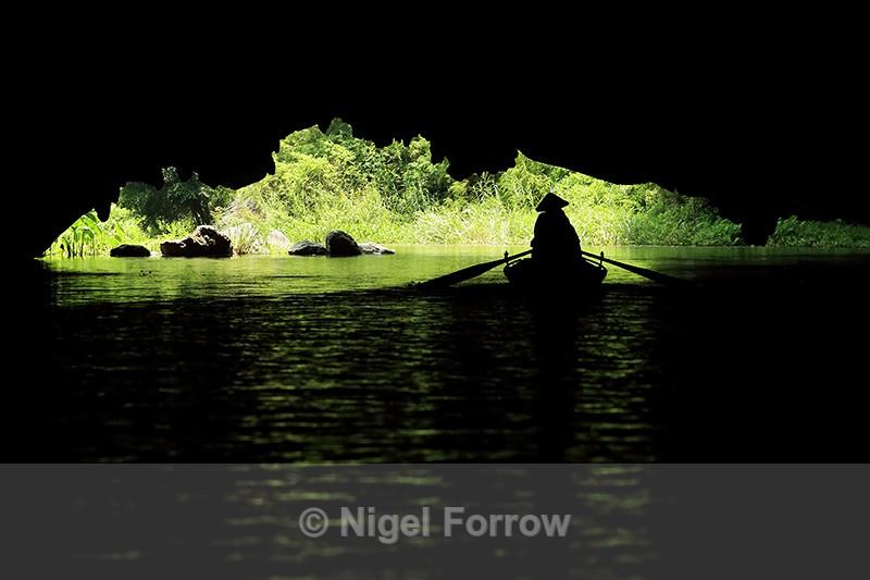 Boat silhouette, Tam Coc caves, Ninh Binh, Vietnam - Vietnam