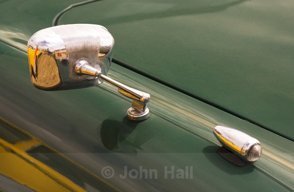 Section Of Wing Mirror And Bonnet Of Vintage Car.