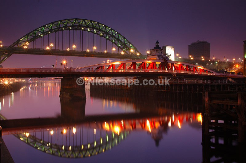 Photograph from the Newcastle Quayside at night featuring the Swing Bridge and Tyne Bridge