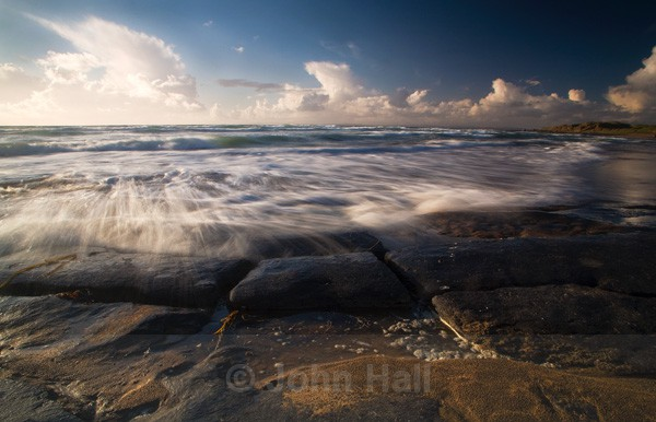wave crashing on burren rocks,fanore beach,co. clare,ireland.