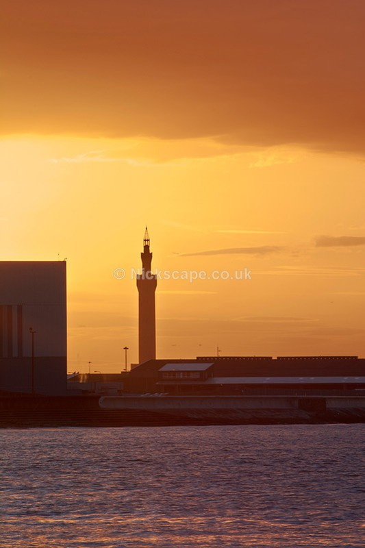 Close up of Grimsby Docks Tower illuminated by the setting sun