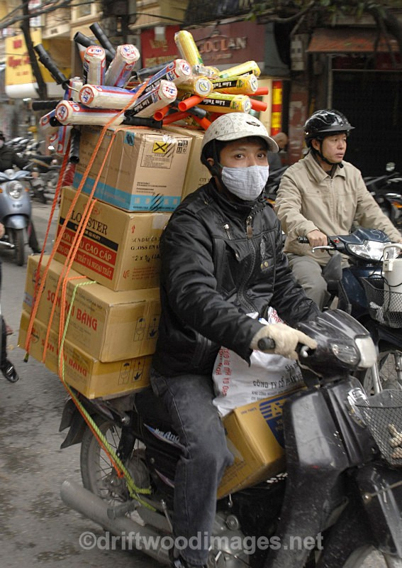 Moving goods by motorbike, Hanoi, Vietnam - South East Asia
