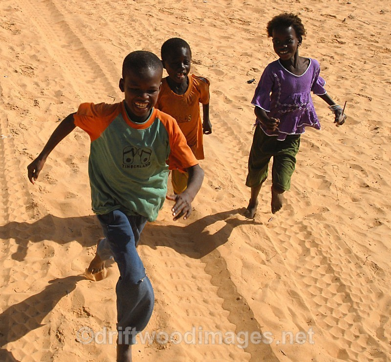 Senegal Fulani three village boys chasing truck  cropped - Senegal Fulani Village