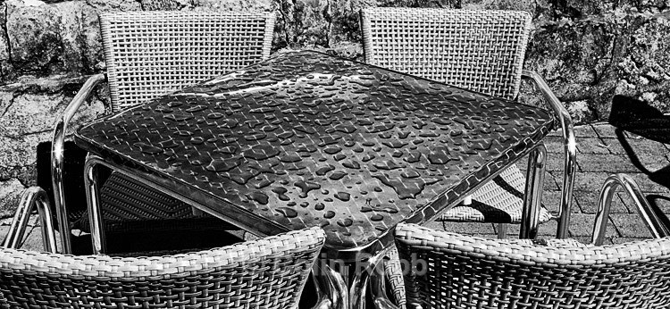 Rain on cafe table | photograph by Colin Robb
