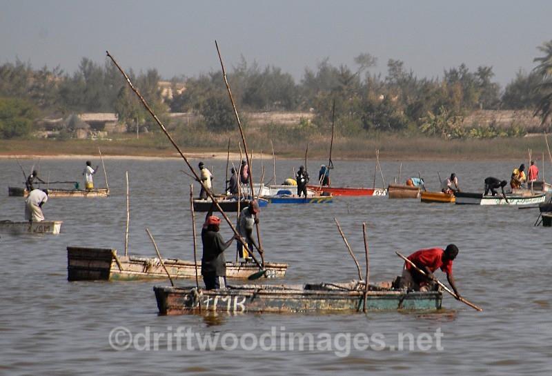 Senegal Lac Rose salt production boats on lake 2 - Salt Production in Senegal