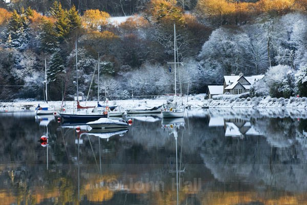 winter reflections on drakes pool near crosshaven co. cork ireland.