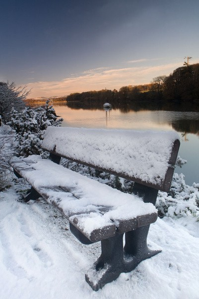 Snow covered seat at drakes pool between carrigaline and crosshaven, co. cork, ireland.