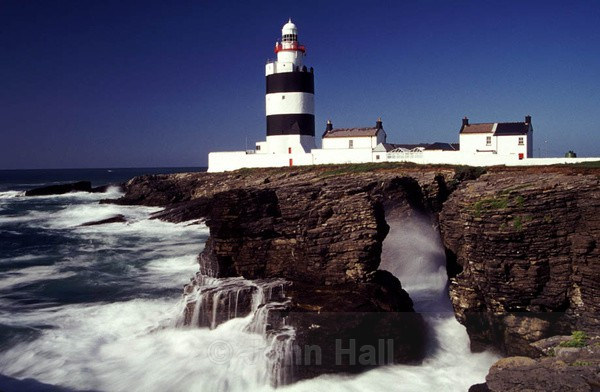 crashing seas at hook head lighthouse, co. wexford, ireland.