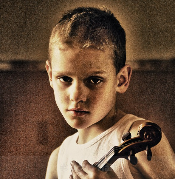 HDR portrait of a boy with fiddle.