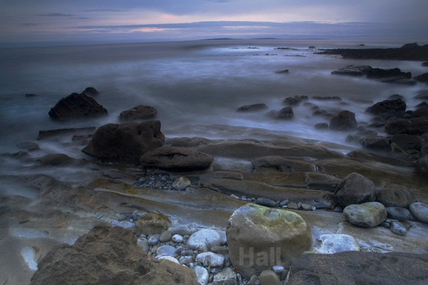 Galway Bay & Aran Islands at sunset seen from The Burren shoreline near Fanore, Co. Clare.