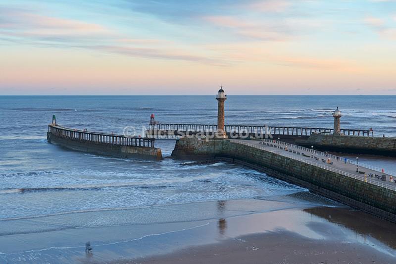 People Enjoying Whitby Piers at Sunrise - Yorkshire Coast - Yorkshire