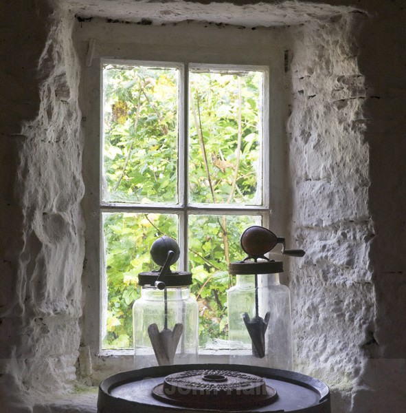 Cottage Window With Jars And Butter Making Churn, Ireland.