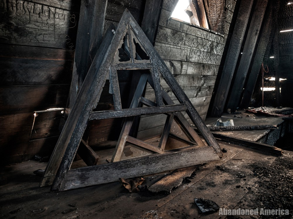 Charred attic at Algonquin River State Hospital | Abandoned America