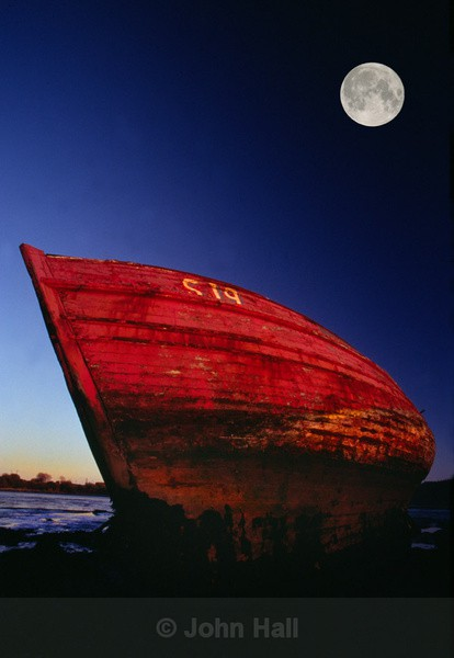 full moon and red boat