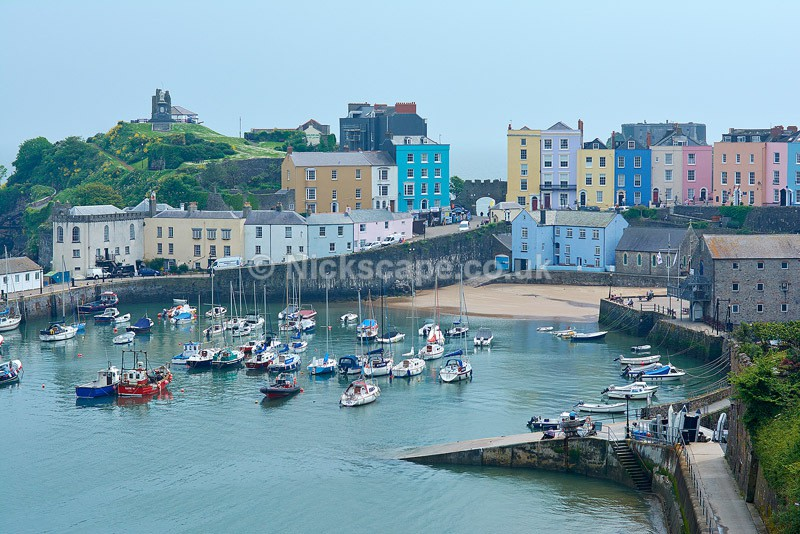 Photo of the famous Harbour at Tenby with Colourful Cottages and Boats