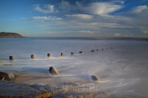 Curving Groynes At Youghal Strand, Co. Cork, Ireland.