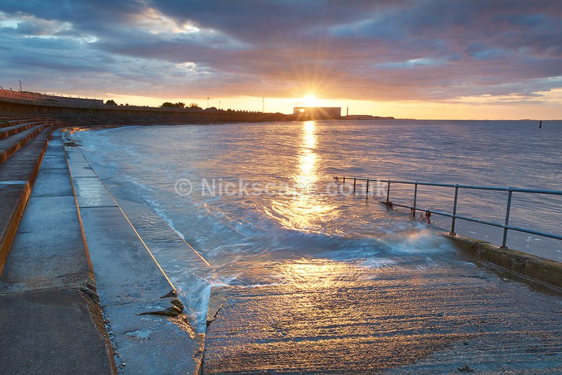 Grimsby Docks at sunset viewed from the seawall at Cleethorpes