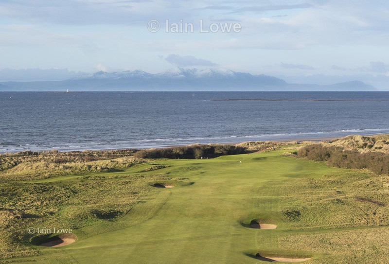 Aerial view of the 10th hole and snow-tipped Arran - Prestwick Golf Links