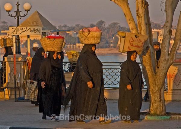Egyptian women on the way to work - Egypt Nile Tour 08