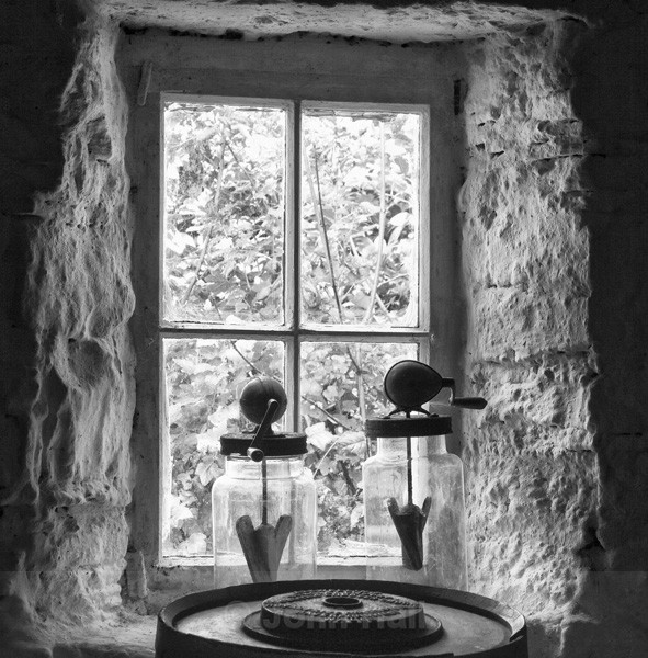 Fine Art Monochrome Of Jars And Butter Making Churn At A Cottage Window In Ireland.