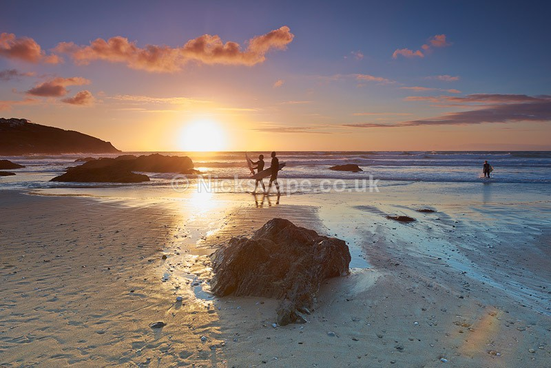 Surfers at sunset on Fistral Beach | Newquay | Cornwall Coastline