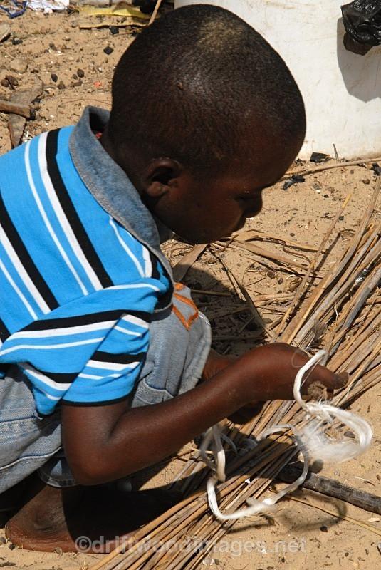 Senegal Fulani Senegal village boy making basket 5 detailo - Senegal Fulani Village