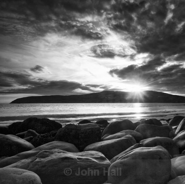 Fine Art Monochrome Of Boulders In Silhouette And Dramatic Sky At Sunset, Mizen, Co. Cork.
