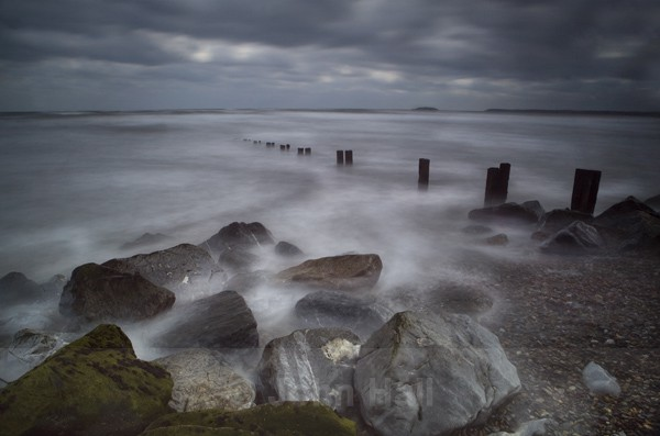 Rocks, Waves And Groynes At Youghal Beach, Co. Cork, Ireland.