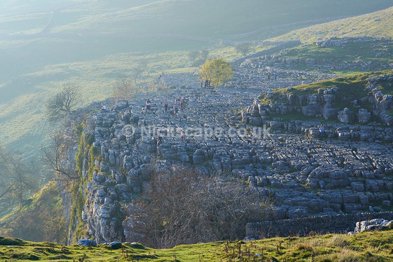 Tourist on the edge at Malham Cover - Yorkshire Dales