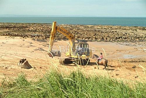 Repairing storm damage. - Land and Sea