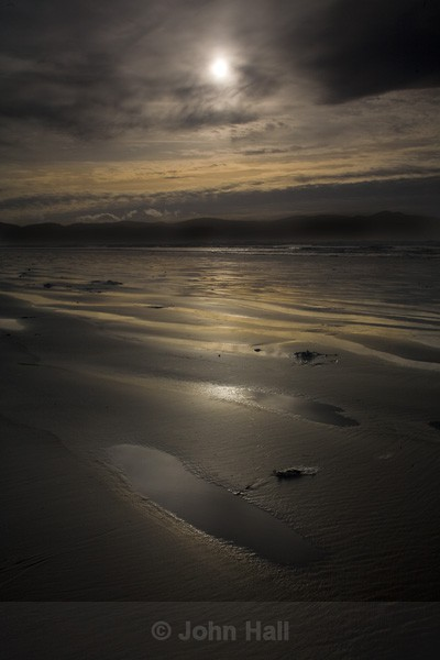 sun & light reflected on inch beach, co. kerry