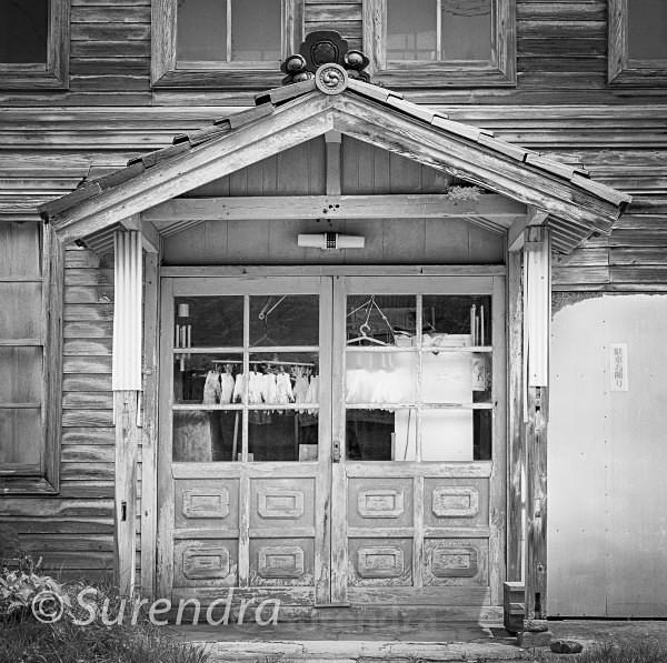 Doorway with Gloves - Buildings in Decline