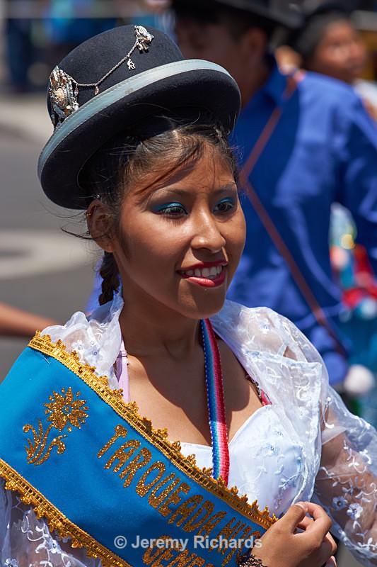 Bolivian dancer in traditional bowler hat - Carnaval Andino Con La Fuerza Del Sol - Arica