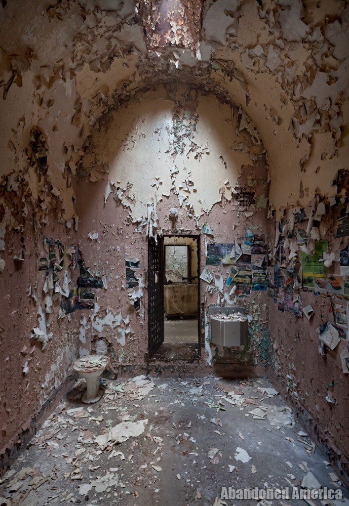 Cell with collaged walls, Holmesburg Prison, Philadelphia PA | Abandoned America by Matthew Christopher