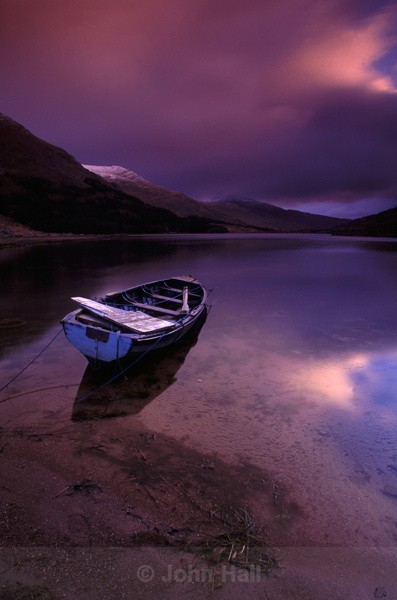 boat on lake at sunrise,black valley,co. kerry,ireland.