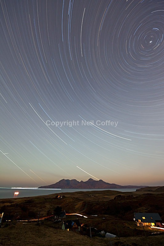 Star trails over Rum from Cleadale, Isle Of Eigg - Portrait format