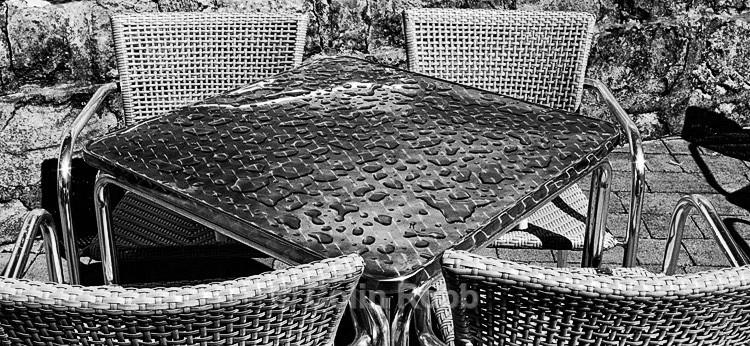 Rain on cafe table   photograph by Colin Robb