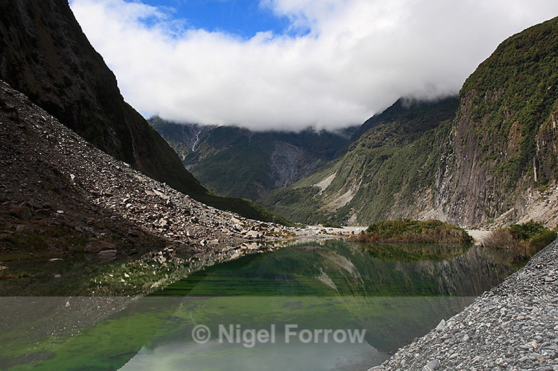 Reflection in lake on the approach to Fox Glacier - New Zealand
