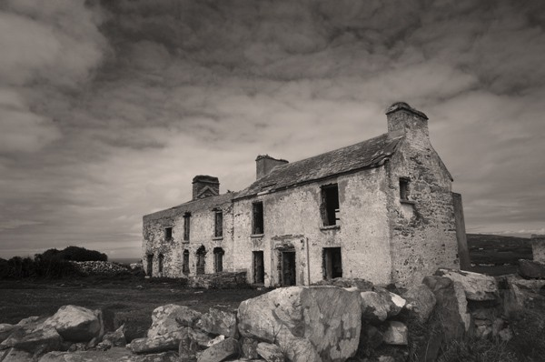 Fine Art Monochrome Of Ruined Houses On Brow Head, West Cork, Ireland.